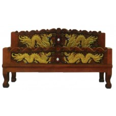 Bed frame with dragon crafts.